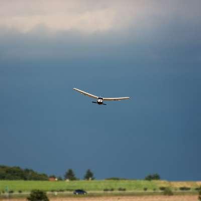 Rc plane and dark sky. Outdoor activity.